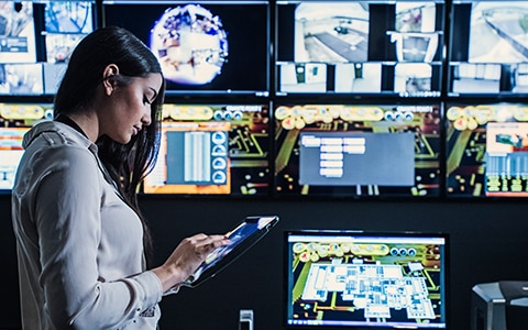 Woman in Security Monitor Room